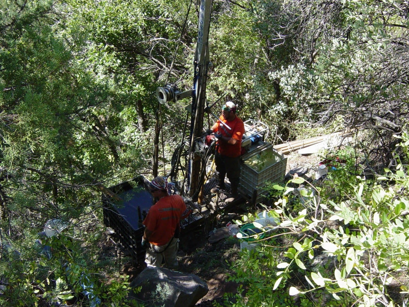 Small footprint drill rig located on a steep heavily wooded slope